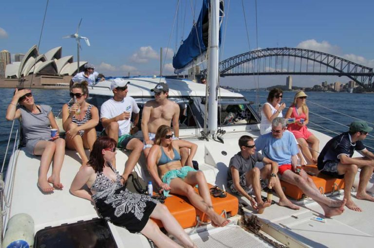 sydney catamaran cruises boys and girls sitting in top of boat